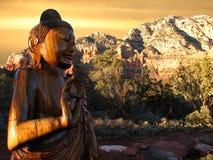 buddha sedonasolnedgång Arkivfoton