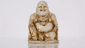 buddha senta-se e sorrisos e risos Imagem de Stock Royalty Free