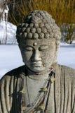 Buddha: serenity in snow. Serene buddha in snowy winter field Stock Photography