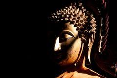 Buddha in shadows Stock Photo