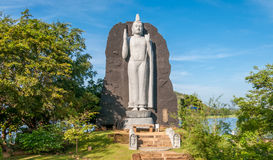 Buddha in Sigiriya. Statue Buddha at Lake in Sigiriya Royalty Free Stock Image
