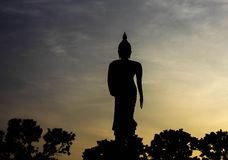Buddha silhouette. Black shadow Buddha statues on monuments in the evening Royalty Free Stock Photos