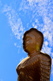 Buddha silhouette on blue sky. Royalty Free Stock Photo