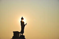 Buddha. Silhouette during sunrise in the morning Stock Photo