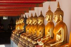 Buddha sitting in line and meditating Wat Pho  temple , Bangkok,. Thailand Stock Photo