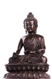 Buddha sitting on a lotus throne in gesture of a donation. The s. Buddha`s figure, brown color made of metal in a meditation pose with the hands located in mudra stock photography