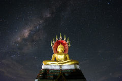 Buddha sitting with the Milky Way. In thailand Stock Photography