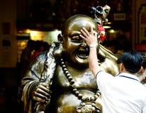buddha skratta Arkivbilder