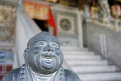 buddha skratta staty Arkivbilder