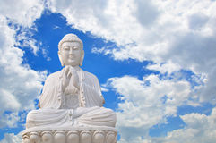 Buddha in the sky. The big Chinese Buddha in the beautiful sky stock image