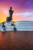 Buddha in the sky after rain.jpg. Sunset light in the sky after rain Stock Images