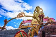 Buddha sleek angle. Beauty buddha sleek angle with Naka and blue sky Stock Photo