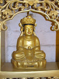 Buddha. A small statue of the Buddha in a child's tomb in the territory of a Buddhist monastery Stock Photos