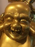 Buddha smile. Happy Buddha with a giant smile and golden skin Stock Images