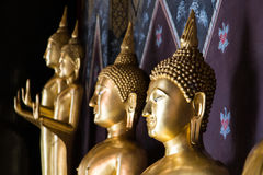 Buddha smiling face. Close golden Buddha smiling face, which is often seen in the beautiful ancient temples Stock Image