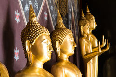 Buddha smiling face. Close golden Buddha smiling face, which is often seen in the beautiful ancient temples Stock Images