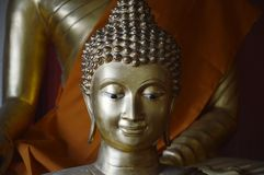 Buddha smiling face. A golden Buddha with a smiling faces Royalty Free Stock Photo
