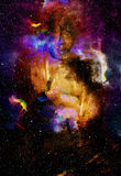 Buddha in space and stars, galaxy background Stock Images