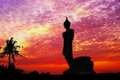 Buddha standing behind the sunset Background Red Brown Orange Heaven Plan Urban View Vibrant Sea Riverside Sunny Tourism Dawn Sunl Stock Photography