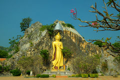 Buddha standing on cliff. Golden Buddha standing on cliff Rachaburi Thailand Stock Photos