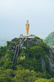 Buddha standing on a mountain Royalty Free Stock Photo