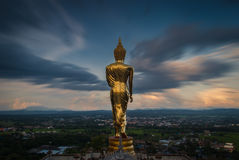 Buddha standing on a mountain Royalty Free Stock Photos