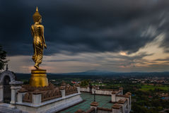 Buddha standing on a mountain Stock Photo