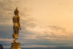Buddha standing on a mountain. In the North of Thailand Royalty Free Stock Photo