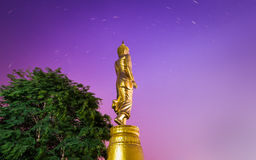 Buddha standing on a mountain with star trail, Nan, Thailand. Royalty Free Stock Image