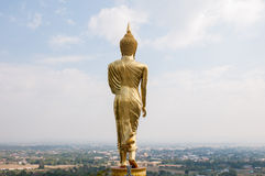 Buddha standing on a mountain Wat Phra That Khao Noi Stock Images