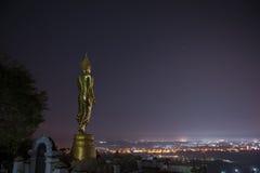 Buddha standing on a mountain Stock Photo