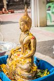 The Buddha stands Prepared for people are pour water of Songkran. Festival day Stock Image