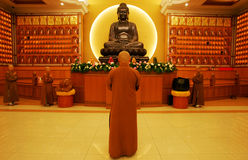 Buddha statue. A devotee praying infront of a Buddha statue stock photos