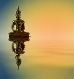 Buddha statue. With reflections in the water. Meditation Stock Photo