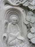 Buddha Statue. Stone craved Buddha Statue with tree Stock Photo