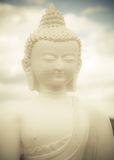 Buddha Statue. Statue of a white Buddha against clouds and sky Stock Photography