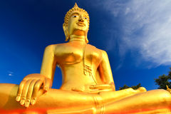 Buddha statue. Golden buddha statue with the beautiful sky Royalty Free Stock Image