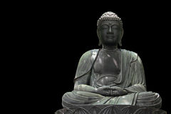 Buddha statue. On black background royalty free stock photos