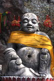Buddha statue. Statue of Buddha seated, wrapped, in yellow cloth Stock Images