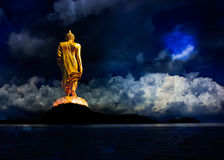 Buddha statue . Buddha statue walking on the mountains Royalty Free Stock Photo