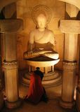 Buddha Statue. Monk offering prayers stock image