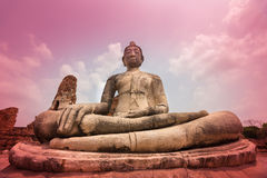 Buddha statue and ancient ruin. Royalty Free Stock Photo