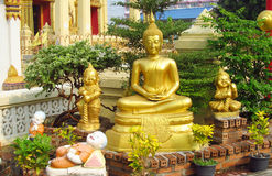 Free Buddha Statue And Laughing Little Monks Near Buddhist Temple Stock Images - 48222284