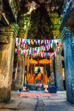 Buddha statue at Angkor Wat - UNESCO World Heritage site near Siem Reap, Cambodia. Interior of an ancient Cambodian temple Angkor Wat in the rays of sunrise Stock Photo