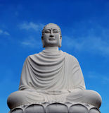 Buddha statue. The Buddha statue on the background of blue sky Stock Image