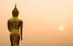 Buddha statue background over scenic sunrise sky twilight color Stock Image