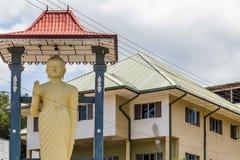 Buddha statue in in Bandarawela in Sri Lanka. Hotel with a buddha statue in front in Bandarawela in Sri Lanka royalty free stock images