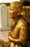 Buddha statue, Bangkok. A golden Buddha statue outside a temple on Ko Kret island, in the middle of the Chao Phraya river in Bangkok stock photography