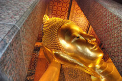 Buddha Statue in a Bangkok Temple, Thailand. The golden statue and the colors of the Temple Royalty Free Stock Image