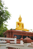 Buddha statue on the base as vertical Royalty Free Stock Photo